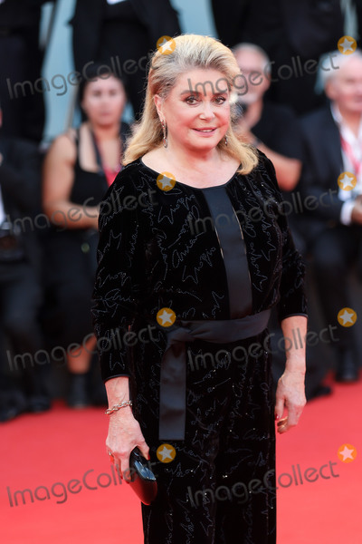 Catherine Deneuve Photo - VENICE ITALY - AUGUST 31 Catherine Deneuve walks the red carpet ahead of the Joker screening during the 76th Venice Film Festival at Sala Grande on August 31 2019 in Venice Italy (Photo by Laurent KoffelImageCollectcom)