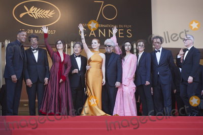 Thierry Fremaux Photo - CANNES FRANCE - MAY 23 (L-R) Jury members Will Smith Gabriel Yared Agnes Jaoui Park Chan-wook Jessica Chastain President of the jury Pedro Almodovar jury members Fan Bingbing Maren Ade Paolo Sorrentino and Director of the Cannes Film Festival Thierry Fremaux attend the 70th Anniversary of the 70th annual Cannes Film Festival at Palais des Festivals on May 23 2017 in Cannes France (Photo by Laurent KoffelImageCollectcom)