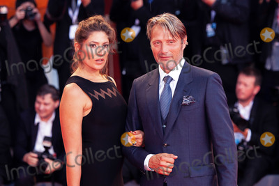 Stella Schnabel Photo - VENICE ITALY - SEPTEMBER 03 Stella Schnabel and Mads Mikkelsen walk the red carpet ahead of the At Eternitys Gate screening during the 75th Venice Film Festival at Sala Grande on September 3 2018 in Venice Italy(Photo by Laurent KoffelImageCollectcom)
