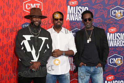 Nathan Morris Photo - NASHVILLE - JUNE 5 (L-R) Wanya Morris Nathan Morris and Shawn Stockman of Boyz II Men attend the 2019 CMT Music Awards at the Bridgestone Arena on June 5 2019 in Nashville Tennessee