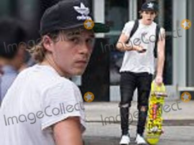Brooklyn Beckham Photo - EXCLUSIVE  Brooklyn Beckham tries out his new skateboard in NYCThe 17-year-old was seen assembling his new board on the sidewalk before joining friends for a ride around the busy streets of Greenwich on Wednesday afternoonHe wore ripped black jeans a white t-shirt and baseball cap The eldest son of former England football captain David Beckham and fashion designer wife Victoria has signed up to a photography course at The New School an arts and design collegeBrooklyn has already been used for shoots by fashion house BurberryLife is looking good for Brooklyn who dates actress Chloe Grace Moritz 19 and learned to drive in a  Pounds 37000 Mercedes C-ClassHe also has 76 million followers on photo-sharing website InstagramPLEASE AGREE FEE BEFORE USAGEPlease contact David Ellis 07967967211 davidellis3copyrighticloudcom