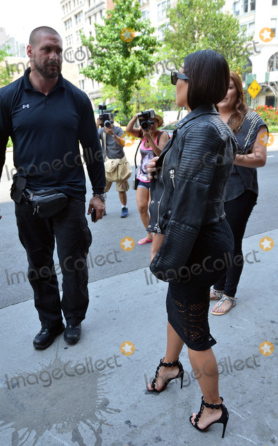 Fanny Pack Photo - ACEPIXSCOMJune 17 2014 New York CityTV personality Kim Kardashian walks in Soho with her current bodyguard on June 17 2014 in New York City The bodyguard who shadows Kim extremely closely wears a Fanny Pack aound his waist at all times which may or may not be a holster The Fanny Pack Holster is a favoured method for concealed carry of a firearm in urban environments for law enforcement and security personnel They can easily conceal a medium sized semi-automatic pistol and two spare magazine or a small framed revolver They allow for discrete comfortable carry and quick and easy deployment should the need occurBy Line Curtis MeansACE PicturesACE Pictures IncTel 646 769 0430