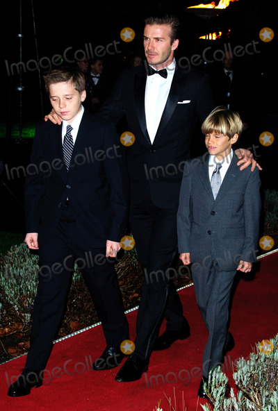 Brooklyn Beckham Photo - David Beckham with his sons (R-L) Romeo Beckham and Brooklyn Beckham at The Sun Military Awards on December 19 2011 in London