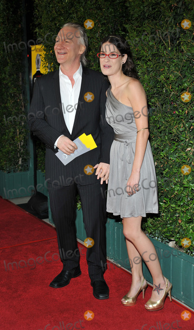 Bill Maher Photo - Bill Maher (L) and his guest Tera Santa Maria arriving at the LA screening of  Capitalism A Love Story on September 15 2009 in Beverly Hills California