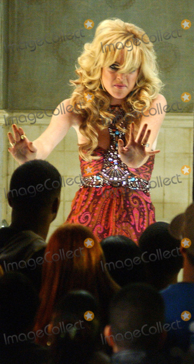 Aliana Lohan Photo - NEW YORK SEPTEMBER 29 2005    Lindsay Lohan continues shooting on the set of her new music video Sister Aliana Lohan is on the set in a ballerina costume and Lindsay continues to wear the paisley halter dress from the first day This day consists of Lindsay in a glass walled bathroom being oggled by onlookers while Lindsay passionately lip syncs to her song