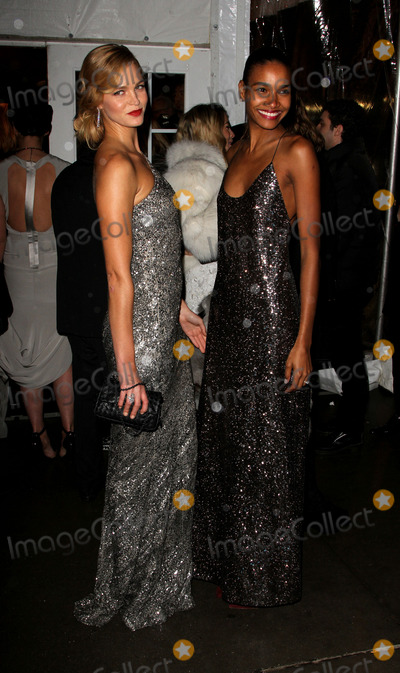 Arlenis Sosa Photo - February 6 2014 New York CityModel Erin Heatherton (L) and Arlenis Sosa arriving at the 2014 amfAR New York Gala at Cipriani Wall Street on February 5 2014 in New York City