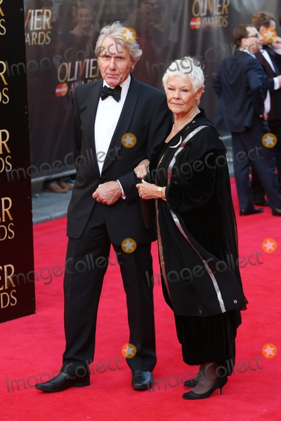 Judi Dench Photo - Judi Dench David Mills arrives for the Laurence Olivier Awards 2014 at the Royal Opera House Covent Garden London 13042014 Picture by Henry Harris  Featureflash