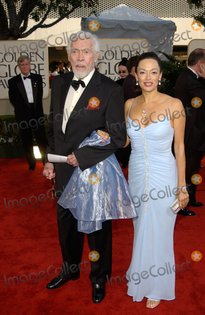 James Coburn Photo - Actor JAMES COBURN  wife PAULA at the 59th Annual Golden Globe Awards in Beverly Hills20JAN2002 Paul SmithFeatureflash