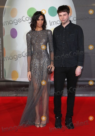 Aluna Francis Photo - George Reid and Aluna Francis arriving for the Brit Awards 2013 at the O2 Arena Greenwich London 20022013 Picture by Henry Harris  Featureflash