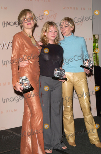 The Ceremonies Photo - Actress SHARON STONE (left) MICHELLE WILLIAMS  ANNE HECHE at the Women in Films Annual Lucy Awards luncheon in Beverly Hills Their TV movie If These Walls Could Talk 2 which was honored at the ceremony