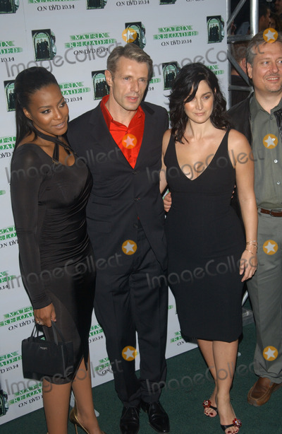 Ann Wilson Photo - NONA GAYE (left)  CARRIE-ANNE MOSS with LAMBERT WILSON at the launch party in Los Angeles for the DVD release of The Matrix ReloadedOct 8 2003 Paul Smith  Featureflash