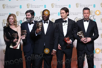 ANTHONY KATAGAS Photo - Dede Gardner Anthony Katagas Steve McQueen Jeremy Kleiner Brad Pitt at the British Academy Film Awards (BAFTA) 2014 held at the Royal Opera House - Winners BoardsLondon 16022014 Picture by Henry Harris  Featureflash