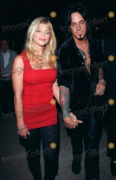 Nicki Sixx Photo - 20JAN98  Baywatch star DONNA DERRICO  husband NICKY SIXX at the world premiere of Great Expectations in Century City Los Angeles