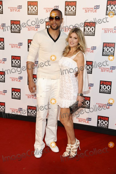 Jon Carew Photo - Jon Carew and designer Hofit Golan arrives for the FHM 100 Sexiest Women 2001 party at No1 Marylebone London 04052011  Picture by Alexandra Glen  Featureflash