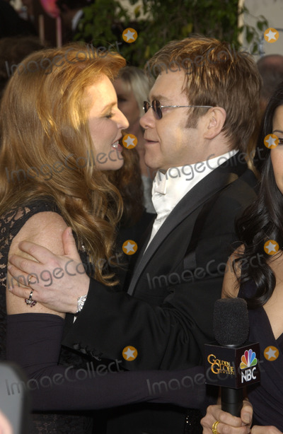 Elton John Photo - SARAH FERGUSON DUCHESS OF YORK with SIR ELTON JOHN at the 61st Annual Golden Globe Awards at the Beverly Hilton Hotel Beverly Hills CAJanuary 25 2004