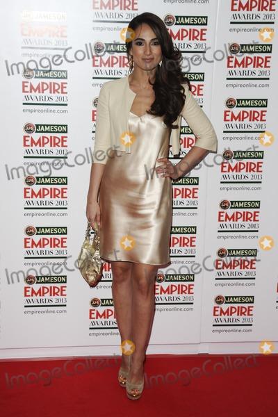 Asli Bayram Photo - Asli Bayram arrives for the Empire Film Awards 2013 at the Grosvenor House Hotel London 24032013 Picture by Steve Vas  Featureflash