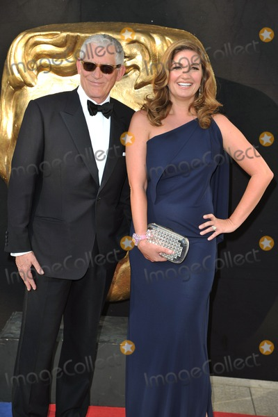 Karen Brady Photo - Nick Hewer and Karen Brady arriving for the BAFTA TV Awards 2012 at the Royal Festival Hall South Bank London 27052012 Picture by Steve Vas  Featureflash