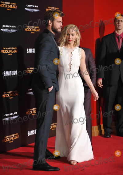 Jennifer Lawrence Photo - Actress Jennifer Lawrence  actor Liam Hemsworth at the Los Angeles premiere of their movie The Hunger Games Mockingjay - Part 2 at the Microsoft Theatre LA Live November 16 2015  Los Angeles CAPicture Paul Smith  Featureflash