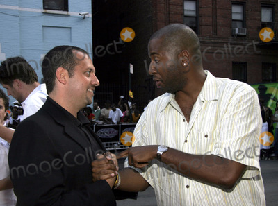 Malcolm D Lee Photo - Producer Bob Tietel (L) and director Malcolm D Lee arrive to the screening of Roll Bounce during opening night of the Urban World Film Festival in June 22 2005 in New York City