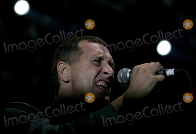 Jon King Photo - Gang Of Fours lead singer Jon King onstage performing during the Across The Narrows concert at Keyspan Park in Coney Island on October 1 2005 in New York City