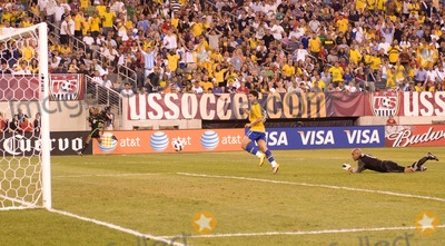 Alexandre Pato Photo - Brazil forward Alexandre Pato (9) watches his shot after dribbling past US goalkeeper Tim Howard (1)  during the US vs Brazil game at the New Meadowlands Stadium on August 10 2010 in East Rutherford New Jersey