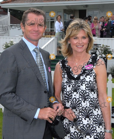 Anthea Turner Photo - Windsor Berkshire UK  TV presenter Anthea Turner and her business husband Grant Bovey  at the Guards Polo Club in  Windsor Great Park  The couple who are said to have recently bought the house of DJTV presenter Chris Evans  for 5 million 21st June 2009 SydLandmark Media