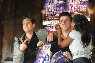 Kelle Bryan Photo - London UK  Anthony Kavanagh Andrew Monk (Simon Cowell lookalike)and Kelle Bryan posing at a photocall for The eXtra Factor a new interactive comedy musical at Salvador  Amanda in central London  21 August 2008Ali KadinskyLandmark Media