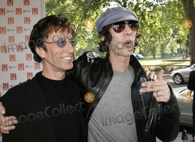 The Bee GEES Photo - London UK Robin Gibb of the Bee Gees (who picked up an award) and Richard Ashcroft  at the Q Awards hosted by Q Magazine at the Grosvenor House Hotel London  10th October 2005 Lisle BrittainLandmark Media