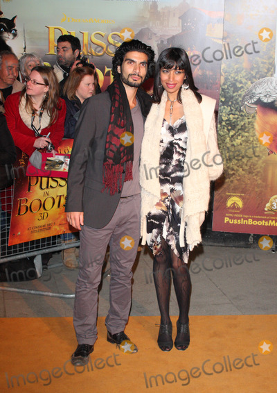 Akin Gazi Photo - London UK Akin Gazi and guest  at the  UK Premiere of Puss in Boots at the Empire Leicester Square London 24th November 2011  Keith MayhewLandmark Media