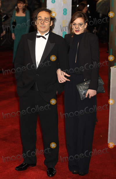 Alexandre Desplat Photo - London UK  Alexandre Desplat   and guest  at  the EE British Academy Film Awards (BAFTAs) at the Royal Opera House in London10th February 2013J AdamsLandmark Media