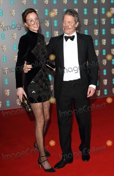Hugh Grant Photo - London UK   Anna Elisabet Eberstein and Hugh Grant    atBAFTA British Academy Film Awards at the Royal Albert Hall London 2nd February 2020  RefLMK73-S2826-030220Keith MayhewLandmark Media WWWLMKMEDIACOM