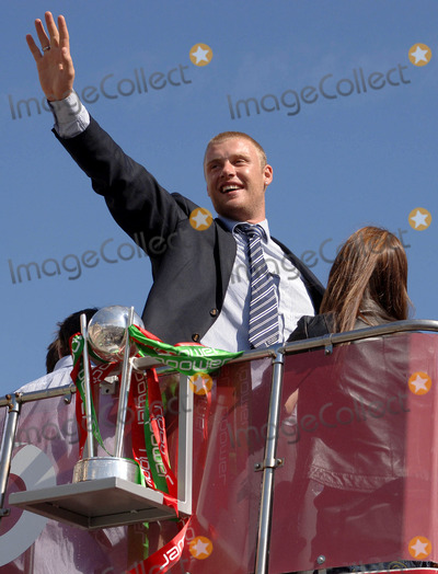 Andrew Flintoff Photo - LondonAndrew Flintoff celebrates winning the Ashes back afer 18 years on the double decker bus that took the England team on a parade through London ending in Trafalgar Square Thousands of fans made an appearance to cheer on their new heros The event has been compared to England winning the Rugby World Cup in 2003 and also the Football World Cup in 1966September 13th 2005Picture by Ali KadinskyLandmark Media