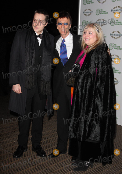 The Bee GEES Photo - London UK Robin Gibb with wife Dwina and son Robin John at The Outward Bound Trust present A Night with Robin Gibb and the music of the BeeGees at Battersea Evolution 9th January 2009 Keith MayhewLandmark Media