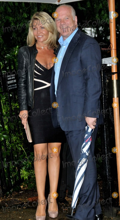 Andy Gray Photo - LondonUK TV Sports pundit Andy Gray with fiance Rachel Lewis   at the David Frost  Summer Garden Party in London 9th July 2008SydLandmark Media