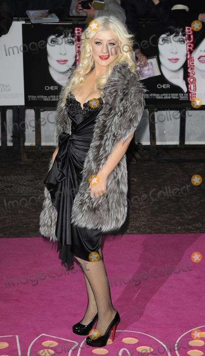 Christina Aguilera Photo - London UK Christina Aguilera ( wearing Stella McCartney dress ) at the UK film Premiere of Burlesque Leicester Square London UK 13th December 2010Can NguyenLandmark Media
