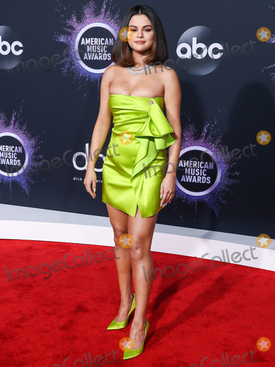Gomez Photo - (FILE) Selena Gomez Makes Big Donation to Cedars-Sinai Amid Coronavirus COVID-19 Pandemic Health Crisis Selena Gomez is making a major donation to Cedars-Sinai LOS ANGELES CALIFORNIA USA - NOVEMBER 24 Singer Selena Gomez wearing a Versace dress and shoes with Roberto Coin jewelry arrives at the 2019 American Music Awards held at Microsoft Theatre LA Live on November 24 2019 in Los Angeles California United States (Photo by Xavier CollinImage Press Agency)