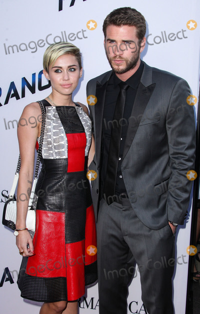 TI Photo - (FILE) Miley Cyrus and Liam Hemsworth Appear to Be Married Miley Cyrus and Liam Hemsworth appeared to have tied the knot six years after getting engaged Miley Cyrus and Liam Hemsworth are believed to have tied the knot in a low-key ceremony at home The singer 26 and actor 28 who got engaged six years ago have been seen cutting their wedding cake in a series of photos on social media LOS ANGELES CA USA - AUGUST 08 Singer Miley Cyrus and boyfriendactor Liam Hemsworth arrive at the Los Angeles Premiere Of Relativity Medias Paranoia held at the Directors Guild of America Theatre on August 8 2013 in Los Angeles California United States (Photo by Xavier CollinImage Press Agency)