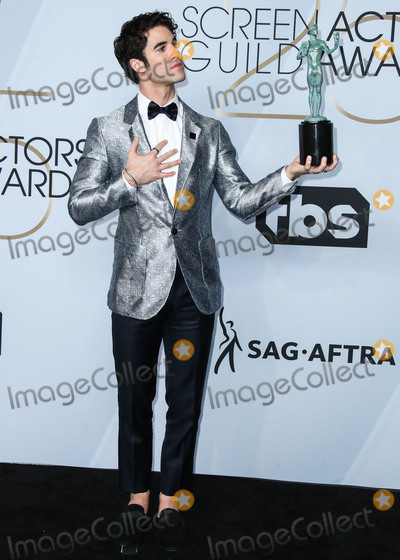 Gianni Versace Photo - LOS ANGELES CA USA - JANUARY 27 Actor Darren Criss winner of Outstanding Performance by a Male Actor in a Miniseries or Television Movie for The Assassination of Gianni Versace poses in the press room at the 25th Annual Screen Actors Guild Awards held at The Shrine Auditorium on January 27 2019 in Los Angeles California United States (Photo by Xavier CollinImage Press Agency)