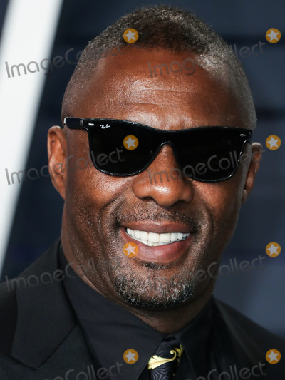 The Actor Photo - (FILE) Idris Elba Tests Positive for Coronavirus COVID-19 Idris Elba has tested positive for coronavirus the actor said on Monday March 16 2020 on Twitter BEVERLY HILLS LOS ANGELES CALIFORNIA USA - FEBRUARY 24 Actor Idris Elba arrives at the 2019 Vanity Fair Oscar Party held at the Wallis Annenberg Center for the Performing Arts on February 24 2019 in Beverly Hills Los Angeles California United States (Photo by Xavier CollinImage Press Agency)