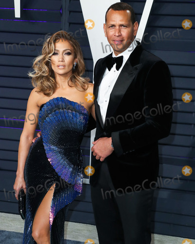 YES Photo - (FILE) Jennifer Lopez and Alex Rodriguez engaged Music icon Jennifer Lopez and retired baseball star Alex Rodriguez are engaged after two years of dating The two celebs who often document their relationship milestones on social media took to Instagram on Saturday night to share the news She said yes Rodriguez said in a post showing JLos hand now bearing a huge engagement ring BEVERLY HILLS LOS ANGELES CA USA - FEBRUARY 24 Singer Jennifer Lopez (wearing Zuhair Murad Couture) and boyfriend Alexander Rodriguez arrive at the 2019 Vanity Fair Oscar Party held at the Wallis Annenberg Center for the Performing Arts on February 24 2019 in Beverly Hills Los Angeles California United States (Photo by Xavier CollinImage Press Agency)