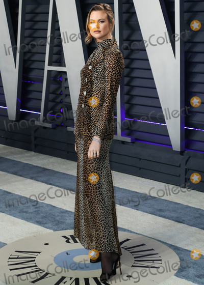 Dolce and Gabbana Photo - BEVERLY HILLS LOS ANGELES CA USA - FEBRUARY 24 Model Behati Prinsloo wearing vintage Dolce and Gabbana arrives at the 2019 Vanity Fair Oscar Party held at the Wallis Annenberg Center for the Performing Arts on February 24 2019 in Beverly Hills Los Angeles California United States (Photo by Xavier CollinImage Press Agency)