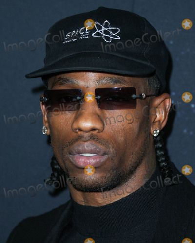 Travis Scott Photo - HOLLYWOOD LOS ANGELES CALIFORNIA USA - DECEMBER 11 Rapper Travis Scott arrives at the Los Angeles Premiere Of A24s Uncut Gems held at the ArcLight Cinerama Dome on December 11 2019 in Hollywood Los Angeles California United States (Photo by Xavier CollinImage Press Agency)