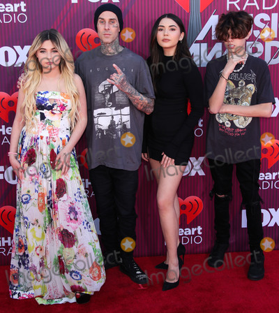 Alabama Barker Photo - LOS ANGELES CA USA - MARCH 14 Alabama Barker Travis Barker and Atiana De La Hoya arrive at the 2019 iHeartRadio Music Awards held at Microsoft Theater at LA Live on March 14 2019 in Los Angeles California United States (Photo by Xavier CollinImage Press Agency)