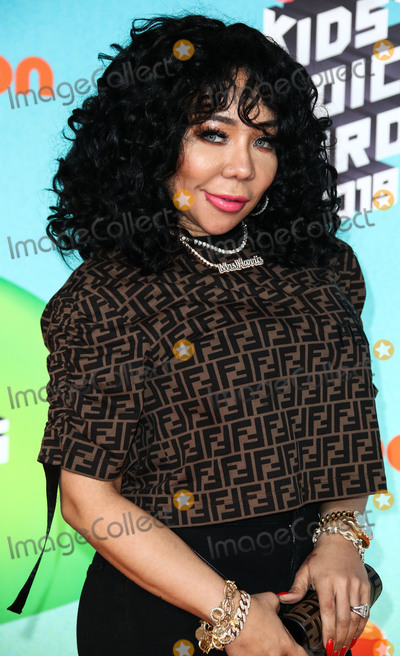 Tameka Cottle Photo - LOS ANGELES CA USA - MARCH 23 Tiny Harris (Tameka Cottle) arrives at Nickelodeons 2019 Kids Choice Awards held at the USC Galen Center on March 23 2019 in Los Angeles California United States (Photo by Xavier CollinImage Press Agency)