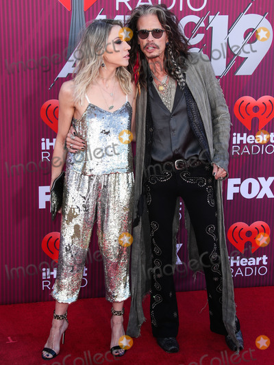 Steven Tyler Photo - LOS ANGELES CA USA - MARCH 14 Aimee Preston and partnersinger Steven Tyler arrive at the 2019 iHeartRadio Music Awards held at Microsoft Theater at LA Live on March 14 2019 in Los Angeles California United States (Photo by Xavier CollinImage Press Agency)