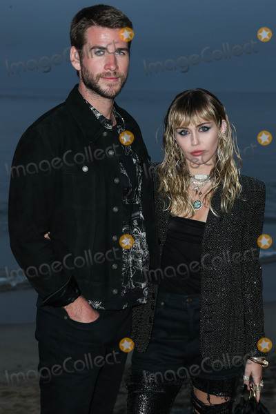 Miley Cyrus Photo - (FILE) Miley Cyrus and Liam Hemsworth Split MALIBU LOS ANGELES CALIFORNIA USA - JUNE 06 Actor Liam Hemsworth and singerwife Miley Cyrus arrive at the Saint Laurent Mens Spring Summer 20 Show held at Paradise Cove Beach on June 6 2019 in Malibu Los Angeles California United States (Photo by Xavier CollinImage Press Agency)
