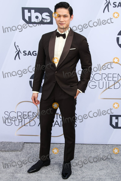 Harry Shum Jr Photo - LOS ANGELES CA USA - JANUARY 27 Actor Harry Shum Jr wearing an Armani tuxedo Christian Louboutin shoes an Anto shirt a Chopard watch and David Yurman cufflinks and ring arrives at the 25th Annual Screen Actors Guild Awards held at The Shrine Auditorium on January 27 2019 in Los Angeles California United States (Photo by Xavier CollinImage Press Agency)