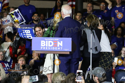 Joe Biden Photo - BALDWIN HILLS LOS ANGELES CALIFORNIA USA - MARCH 03 Former Vice President Joe Biden 2020 Democratic presidential candidate right watches as his wife Jill Biden center blocks a protester holding a sign that reads Let Dairy Die from arriving on stage during the Jill and Joe Biden 2020 Super Tuesday Los Angeles Rally held at the Baldwin Hills Recreation Center on March 3 2020 in Baldwin Hills Los Angeles California United States (Photo by Xavier CollinImage Press Agency)