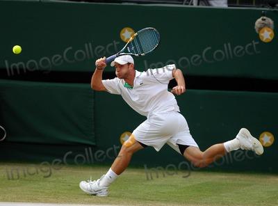 Andy Murray Photo - 062081 Andy Roddick Andy Murray Vs Andy Roddick Wimbledon Tennis Championships 2006 Day 6 at Wimbledon in London 07-01-