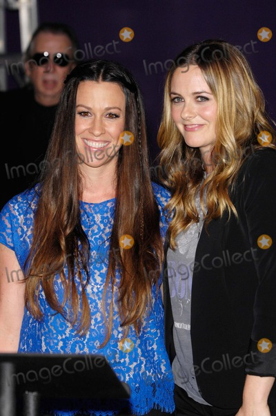 Alanis Morissette Photo - Alanis Morissette and Alicia Silverstone During a Ceremony Inducting Alanis Morissette Into Hollywoods Rockwalk August 21 2012 in Los Angeles Photo Michael Germana - Globe Photos